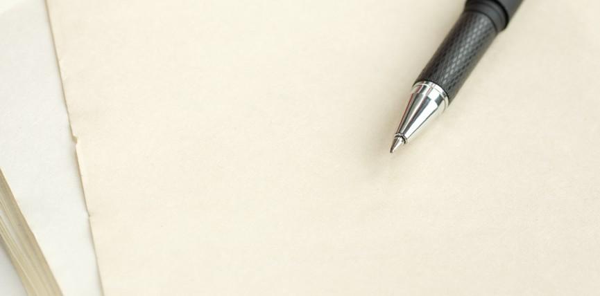 Black pen on a paper. Macro.